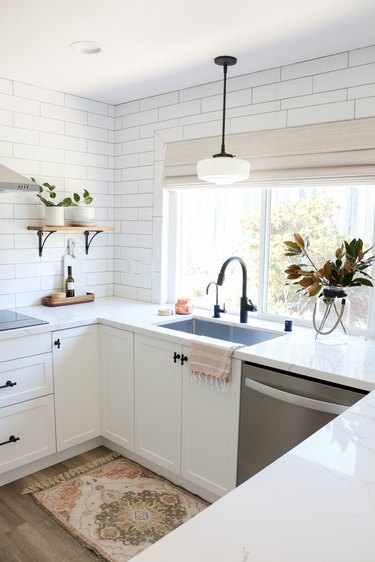 IKEA kitchen style with white tile and white cabinets