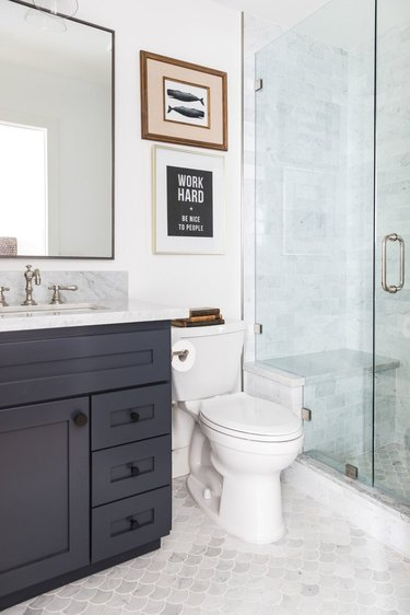 Gray and white fish scale tile coastal flooring idea in bathroom with black vanity