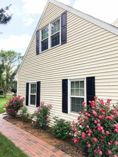Black raised panel  exterior shutter style on cream exterior