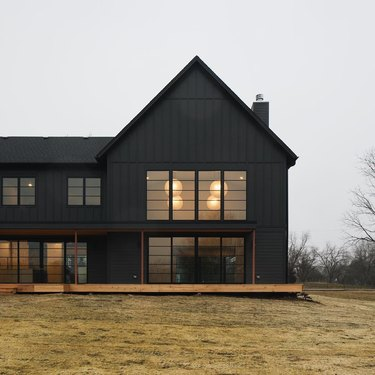 black exterior modern farmhouse with large windows