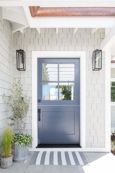 Navy blue and gray exterior beach house colors with shake siding and striped doormat