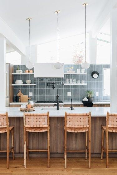 midcentury kitchen lighting idea with A-frame architecture and blue tile backsplash