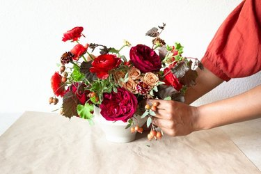 colorful fall centerpiece with roses in vase on table