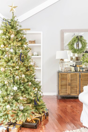 neutral boho inspired Christmas Tree Decoration ideas in living room with wood floor
