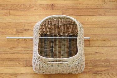 Steel rod inserted through basket
