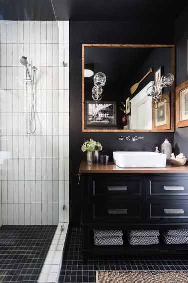 black walls with black flooring and black vanity cabinet