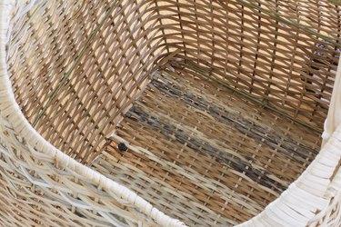 Bolt secured inside basket with nut