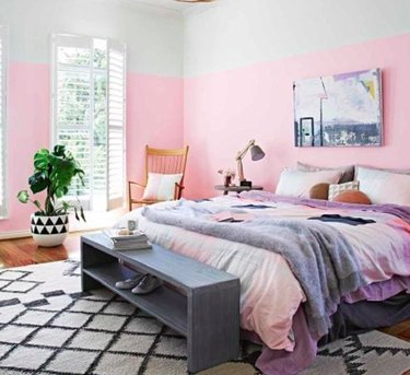 pink bedroom with bed bench and rocking chair
