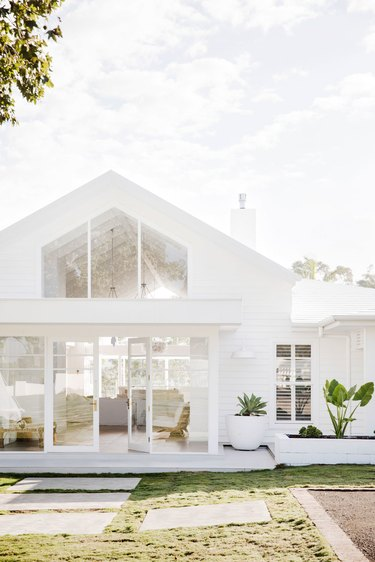 all white home exterior  with oversize windows