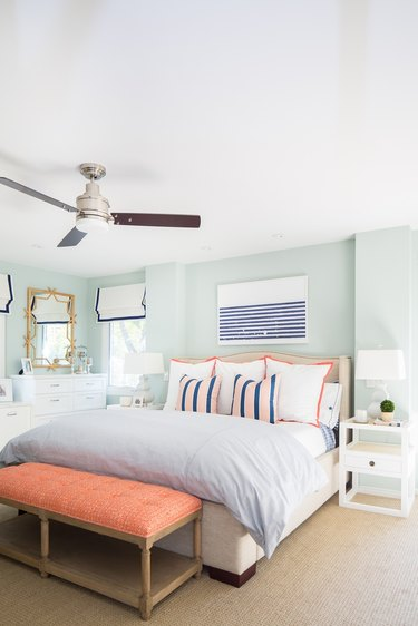 Classic coastal bedding idea with striped artwork and striped bedding
