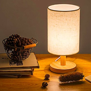 Nightstand with table lamp.