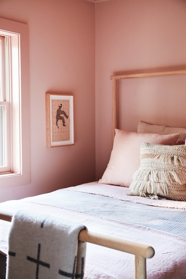bedroom with pink walls and pink bedding
