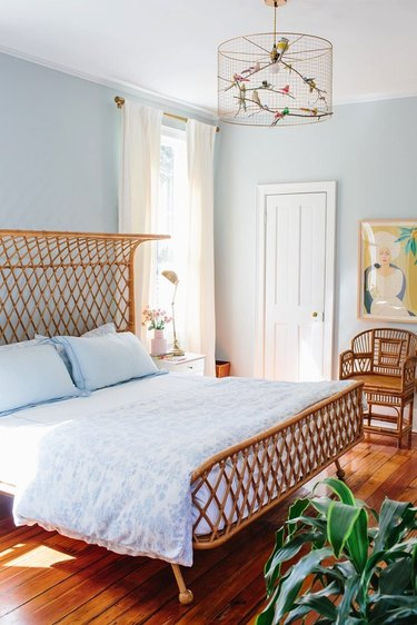 Light blue bedroom with woven rattan bed