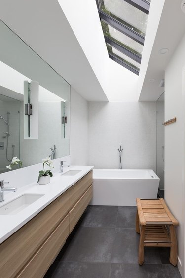 Modern white undermount bathroom sinks with solid surface countertop and wood vanity