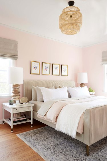 soft pink bedroom with natural accents and IKEA pendant