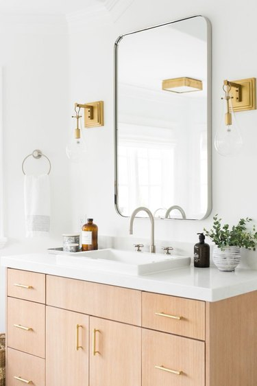 self-rimming bathroom sink with wood vanity and white countertop