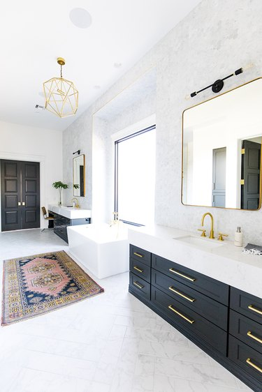 bathroom with his and hers black vanity cabinets