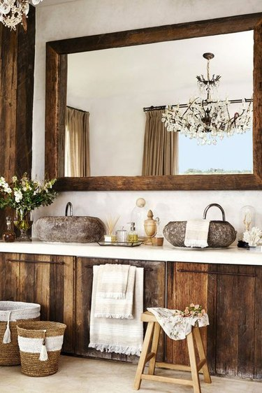 Bathroom with rustic wood mirror and cabinetry