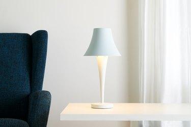 table lamp near sofa chair