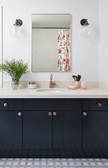 black bathroom vanity with bronze hardware