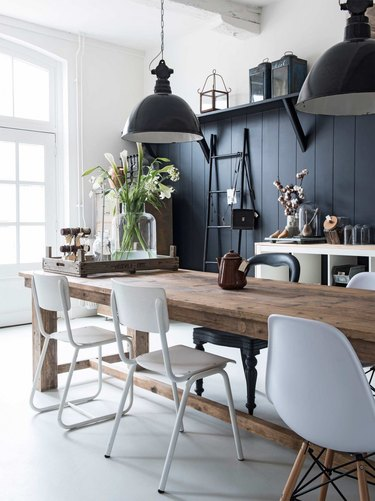 rustic dining room with industrial style pendant lights