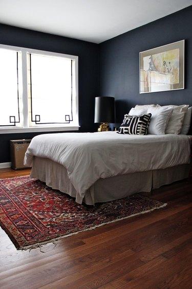matte navy blue bedroom walls with oriental area rug