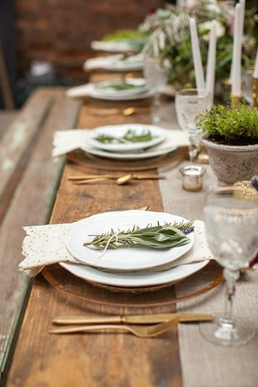 Elegant place settings on rustic dining table