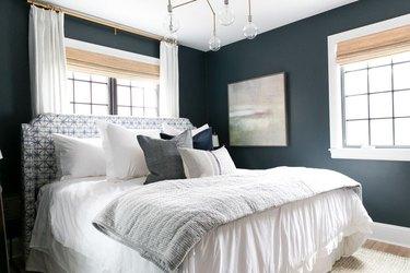 blue-green bedroom with brass chandelier