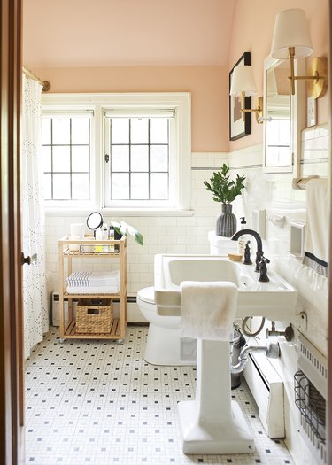 bathroom pedestal  sink with white and black mosaic tile flooring and blush walls