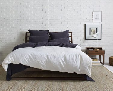 Bed with white linen sheets