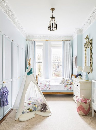 light blue nursery with white crib