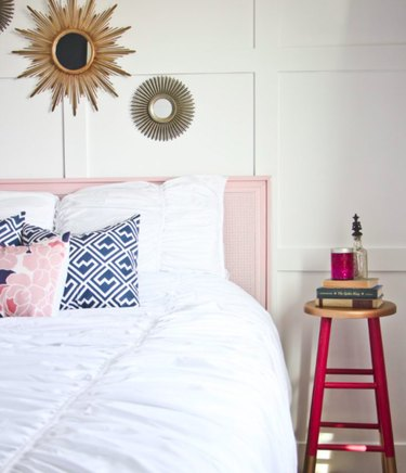 pink guest bedroom idea with DIY side table and pink headboard