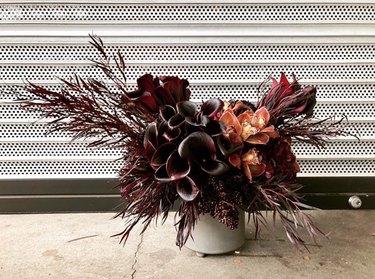 monochrome maroon fall flower arrangement