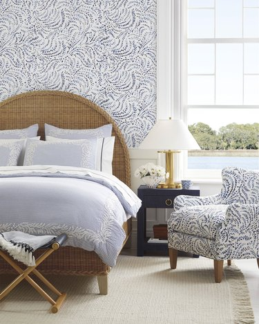 fern-patterned wallpaper and chair in coastal bedroom