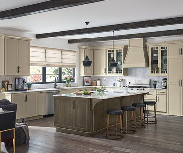 cream color cabinets in kitchen with exposed beams