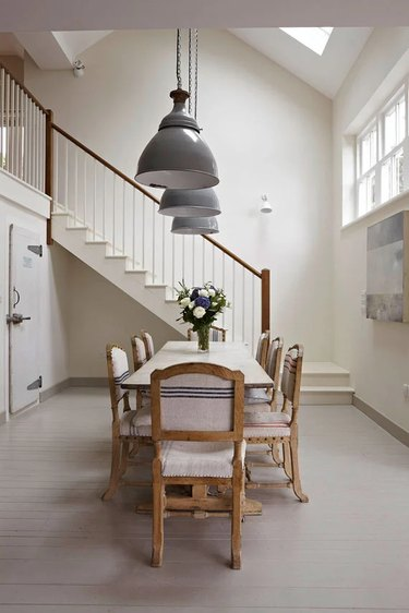 cream color dining room with pendant lights