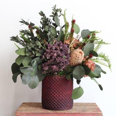 dried fall flower arrangement in jewel tones