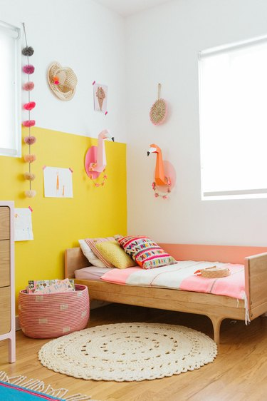 yellow kids bedroom idea with color blocking on walls and toddler bed