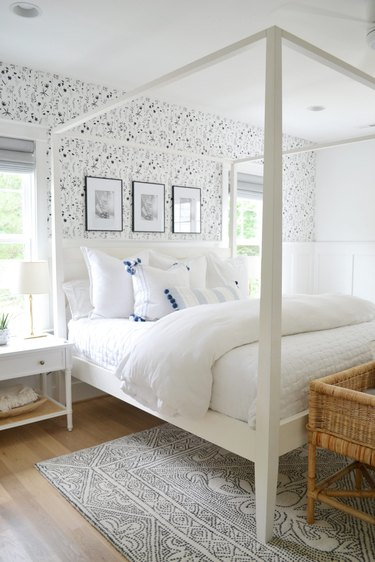 seashell-print wallpaper in coastal bedroom with canopy bed