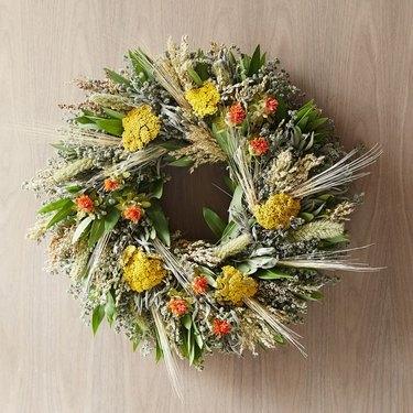 fall flower arrangement orange yellow and green wreath