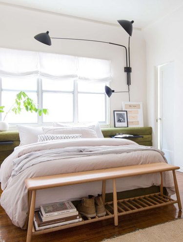 relaxed Roman shades at windows in bedroom