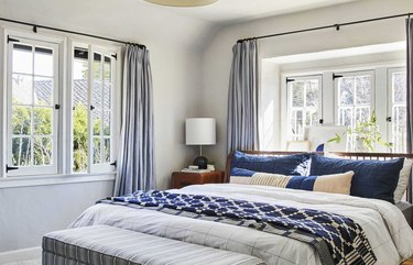 navy and white coastal bedroom with modern undertones