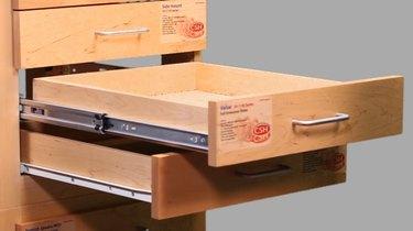 Side mount drawer glides.
