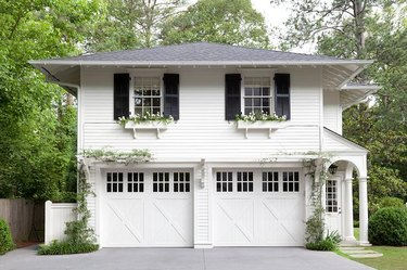 white house exterior with carriage style garage doors