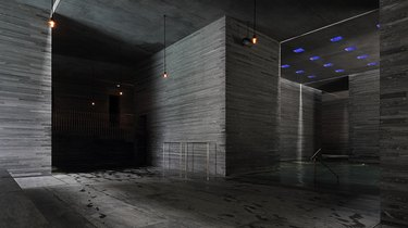 dark minimalist room with blue ceiling lights