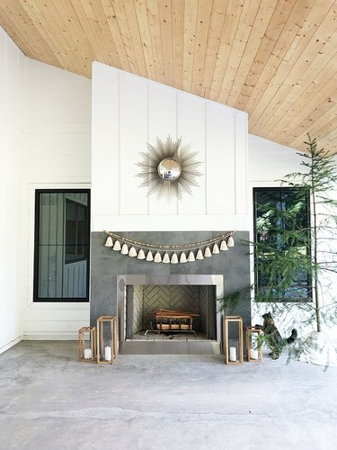 White exterior paneling on modern outdoor fireplace