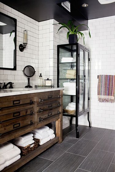 white bathroom with subway tiles and wooden industrial bathroom vanity
