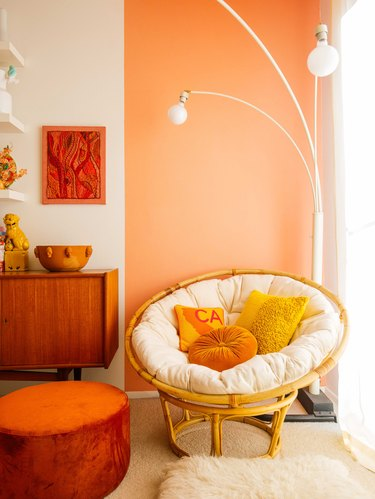 Red, orange, and yellow tertiary colors in a reading nook