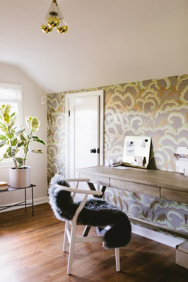 finished attic idea with office showcasing colorful wallpaper accent wall