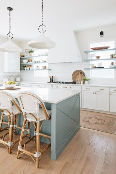 White subway tile coastal backsplash in green and white kitchen